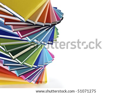 Spiral stack of multi-colored real books on white background, top view. - stock photo