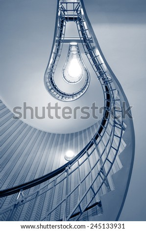 Spiral Staircase. Abstract image of stairs in shape of light bulb. - stock photo