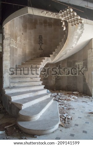 Spiral staircase in an abandoned hotel after the war in Croatia - stock photo