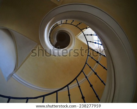 Spiral staircase in historic church - stock photo