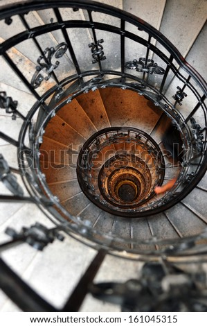 spiral staircase in old house - stock photo