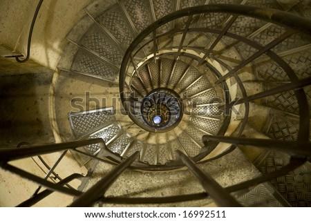 Spiral staircase in the Arc de Triomphe Paris - stock photo