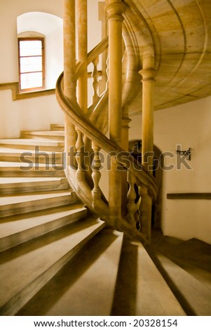 Spiral staircase in the castle - stock photo