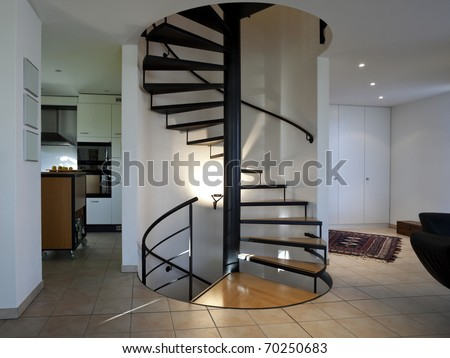 spiral staircase inside a modern home - stock photo