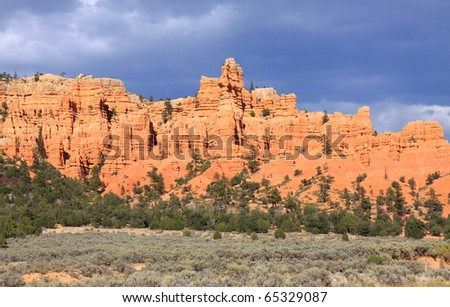 Spires of orange, red and coral sandstone populate Bryce Canyon National Park - stock photo