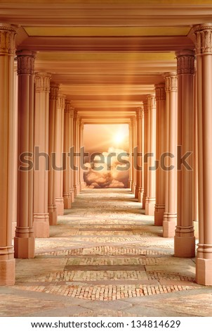 Spiritual fantasy scene with a passageway surrounded by pillars leading to Heaven - stock photo