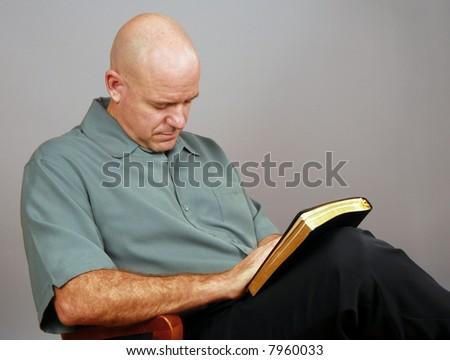 Spiritual Man Holding Bible - stock photo