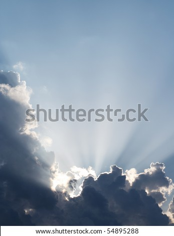 Spiritual sun rays through the clouds. Sky vertical background. - stock photo