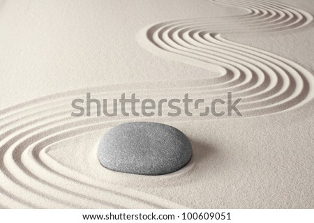spiritual zen meditation background in Japanese rock garden concept for harmony balance simplicity sand and pebble tao or Buddhism - stock photo