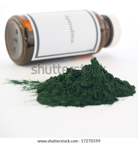 "Spirulina bottle and powder isolated on white. The generic ""Spirulina"" label was made for the photo shoot, no infringement issues."