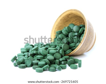 spirulina in a bowl on a white background - stock photo