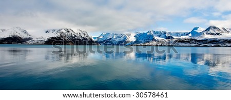 Spitsbergen reflection of the mountains in tranquil sea - stock photo