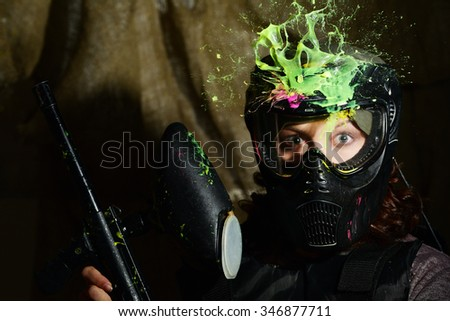 Splash after direct hit to protecting mask in the paintball game  - stock photo