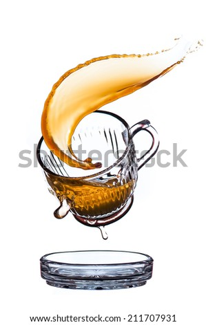 Splash coffee in glass cup, isolated on white background. - stock photo