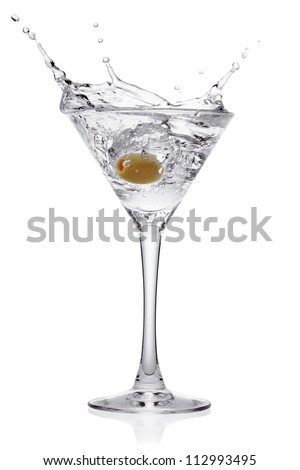 Splash from olive in a glass of cocktail, isolated on the white background, clipping path included.