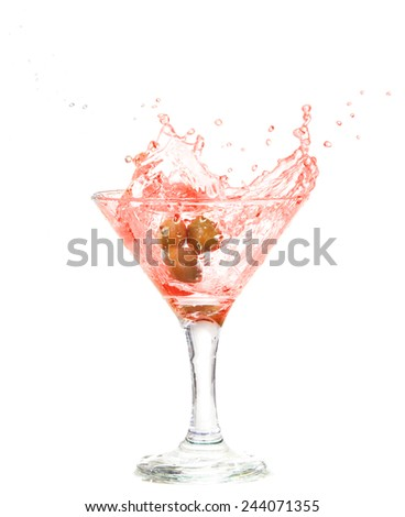 Splash from olive in a glass of cocktail, isolated on the white background, clipping path included. - stock photo