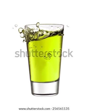 Splash in a glass of green lemonade - stock photo
