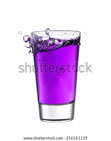 Splash in a glass of purple lemonade isolated on white background - stock photo