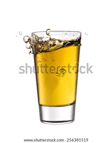 Splash in a glass of Yellow lemonade isolated on white background - stock photo