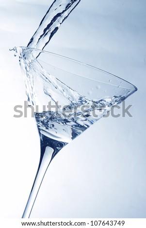 Splash in a martini glass - stock photo