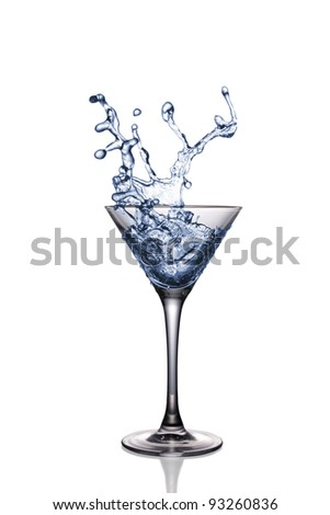 Splash in a martini glass on white background