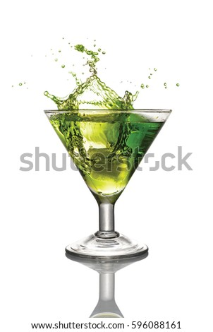 Splash in glass of green alcoholic cocktail drink with ice isolated on white background