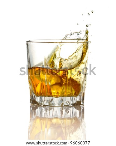 Splash in glass of whiskey and ice isolated on white background