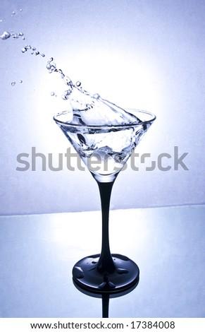 splash in martini glass - stock photo