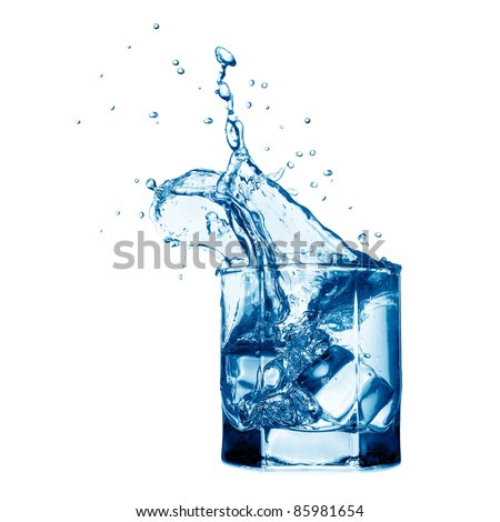 Splash in the glass with water - stock photo