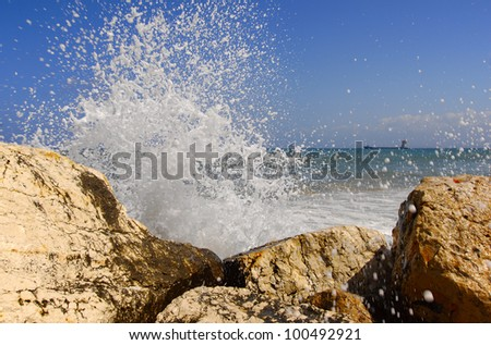 Splash of breaking waves & ship - stock photo