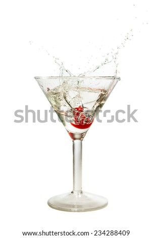 Splash of cherry in martini glass isolated on white background - stock photo