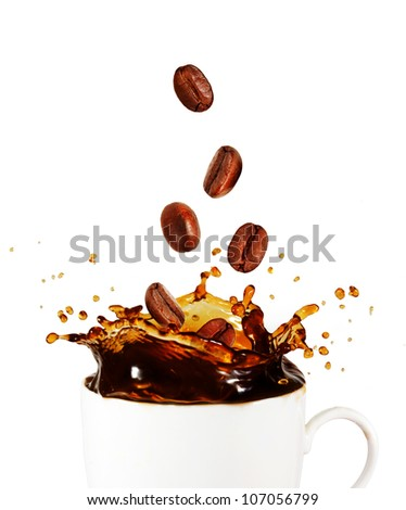 Splash of coffee with coffee beans - stock photo