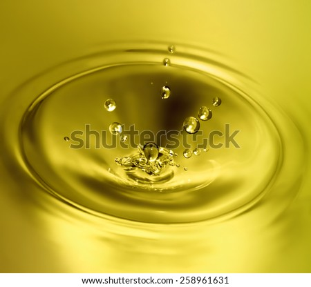 splash of olive oil closeup - stock photo