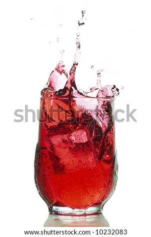 splash of red liquid could be cranberry juice, grape juice - stock photo