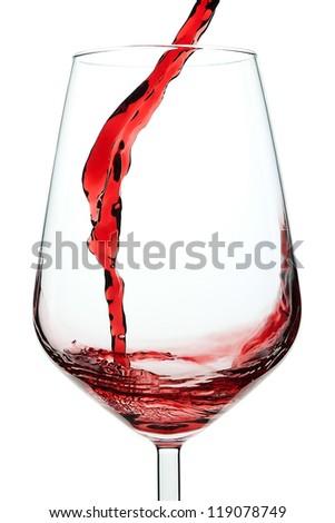 Splash of red wine in a glass. Closeup. - stock photo