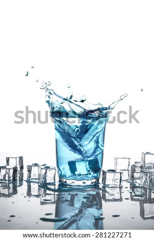 Splash of water in glass isolated on white background