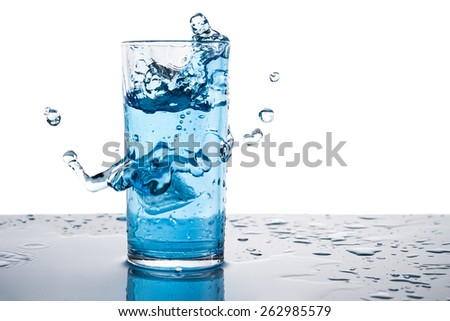 splash of water on a glass isolated white background - stock photo
