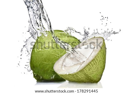 splash of water on green coconut isolated on white - stock photo