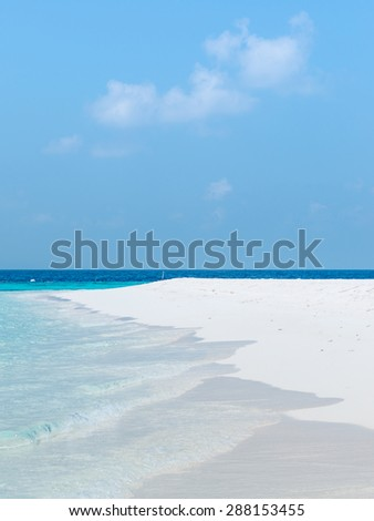 Splash of waves on the white sand beach. Maldives, Ari Atoll. - stock photo