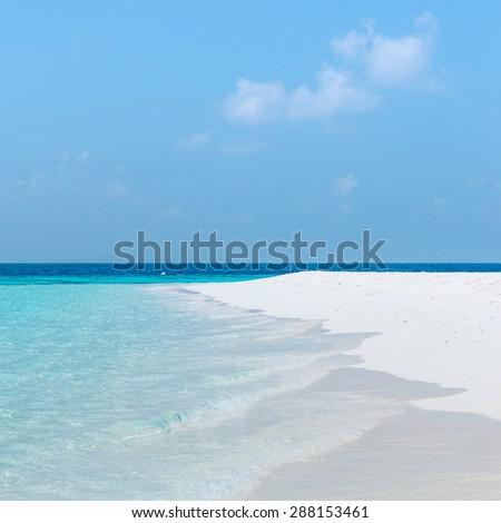Splash of waves on the white sand beach. Maldives, Ari Atoll. - stock photo
