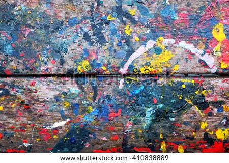 Splash paint on wood - stock photo