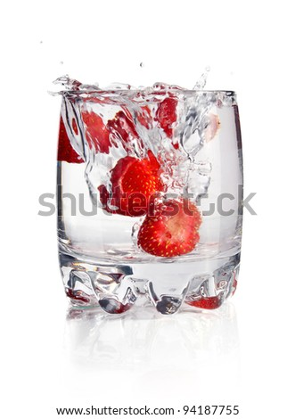 splash water in glass with strawberry isolated on white background - stock photo
