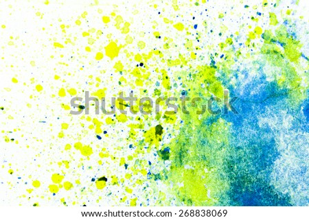 splashes and streaks of watercolor paint on white paper - stock photo