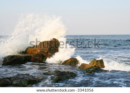 Splashes of the sea wave on the stones - stock photo