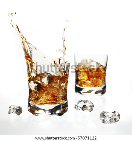 Splashing, dynamic splash of whisky with ice cube on white background