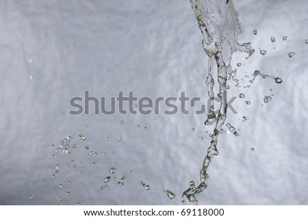 Splashing fresh blue water. Background aqua drop.