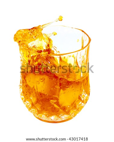 Splashing golden liquor (whisky,rum,bourbon) in a glass isolated on white