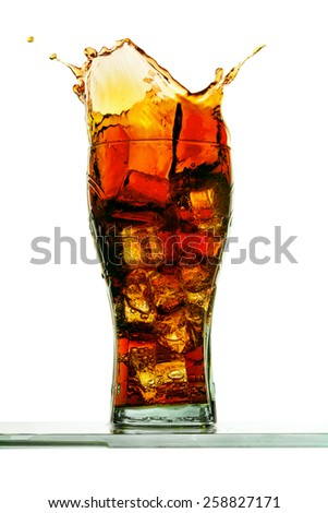 Splashing of cola with ice in glass isolated on white - stock photo