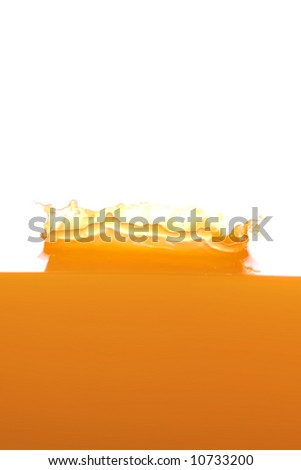 Splashing orange juice - stock photo