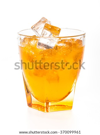 splashing orange juice in glass over white background - stock photo